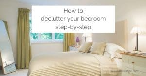 """Clutter-free bedroom with the bed made and a mirror in the corner, with an overlay that reads: """"How to declutter your bedroom step-by-step"""""""