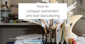 """View of a cluttered home office, with a text overlay that reads: """"How to conquer overwhelm and start decluttering"""""""