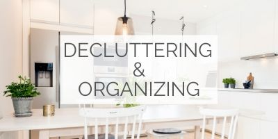 "Image of an organized uncluttered kitchen, with a text overlay that reads: ""Decluttering and organizing"""