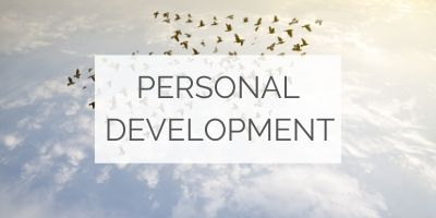 "A flock of birds soaring towards the sky, with a text overlay that reads: ""Personal development"""