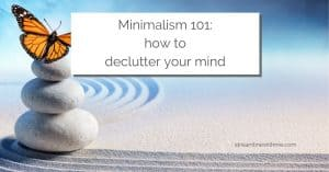 "Three stacked light gray pebbles on raked sand, with an orange butterfly sitting on top, and a text overlay that reads: ""Minimalism 101: how to declutter your mind"""